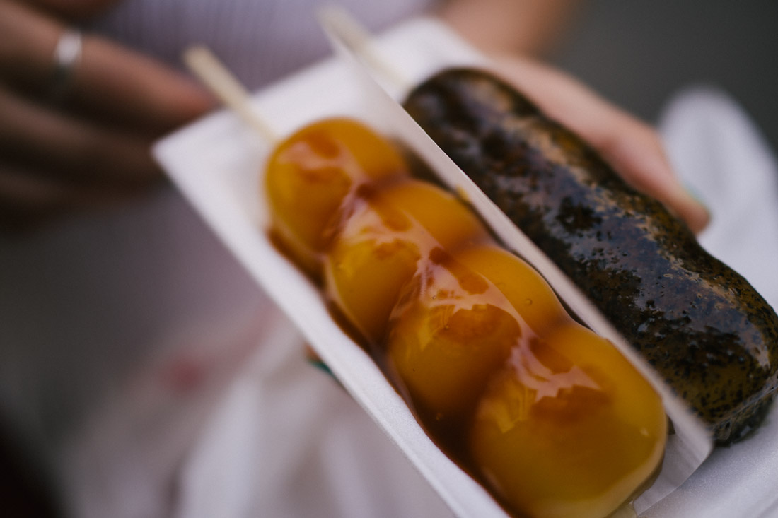 Dango; traditional sugar and soy sauce on the left, sesame sauce on the right.