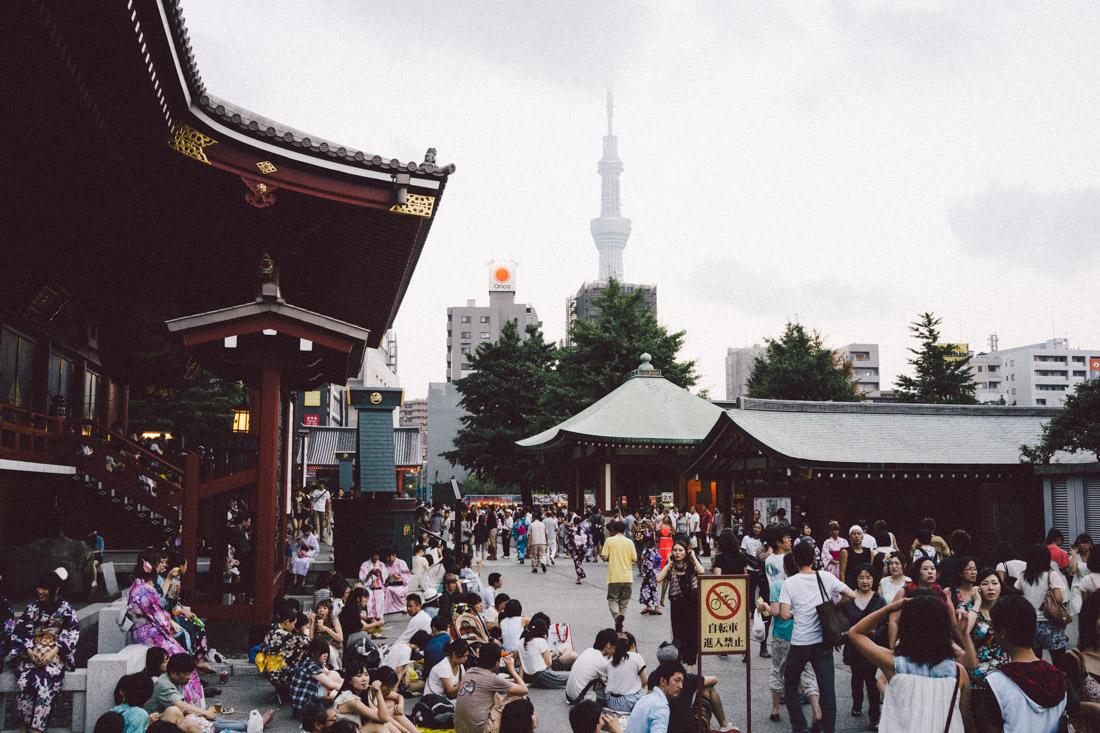 Masses gathered around Senso-ji grounds throughout the day.