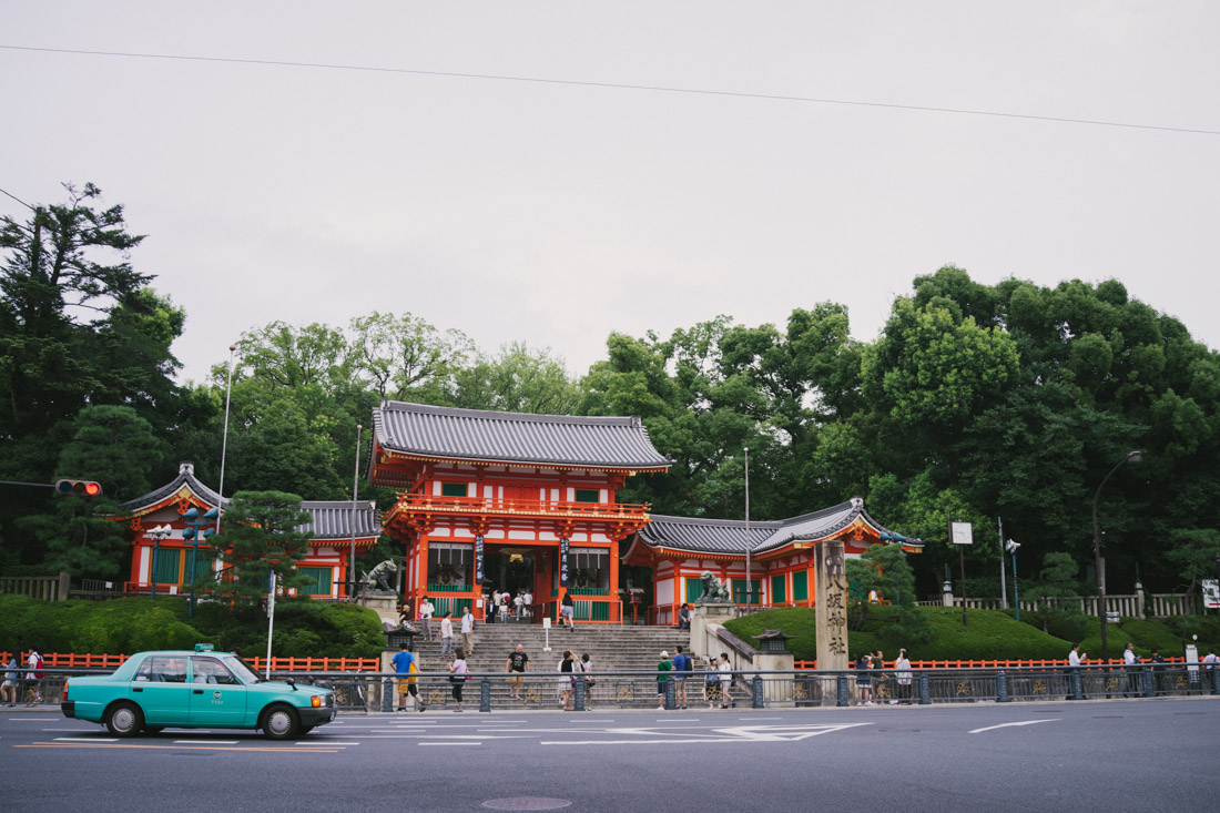 At the end of Shijo street, Yasaka shrine made itself visible with the gate bright colors.