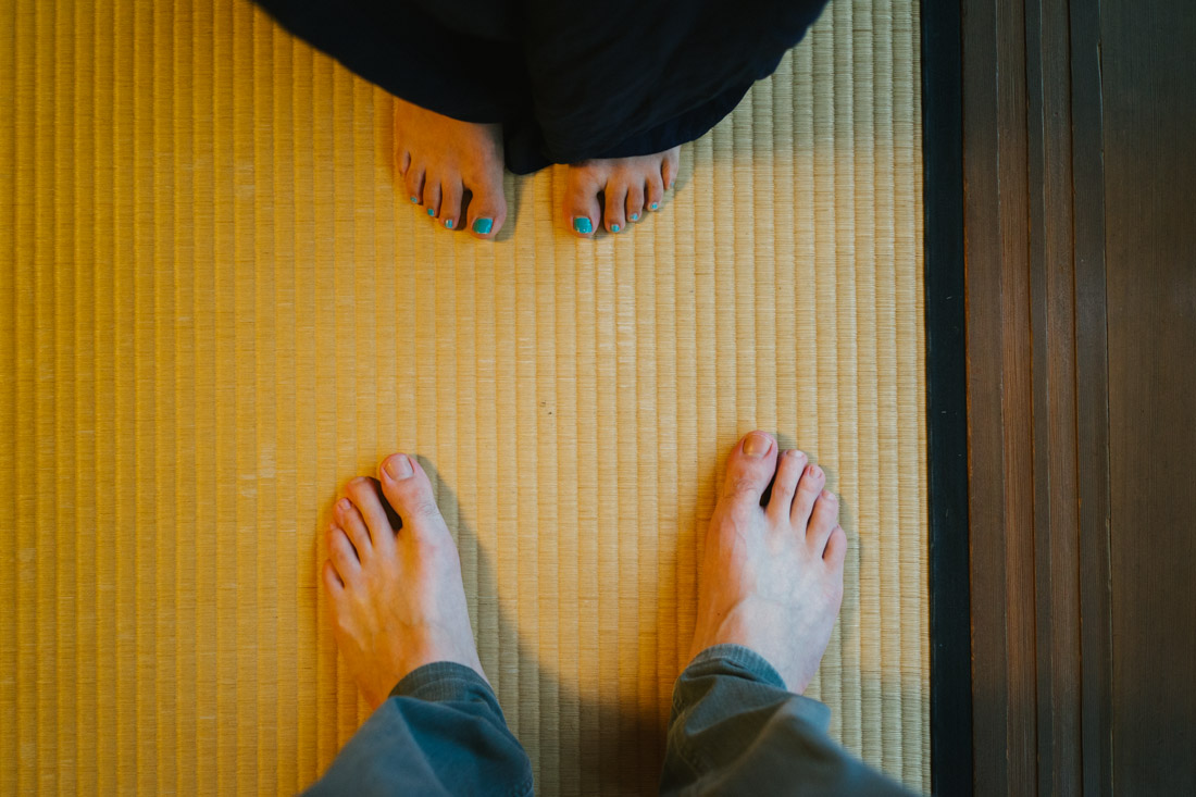 You can not step on a tatami mat with your slippers on, you must be barefoot to walk inside the room.