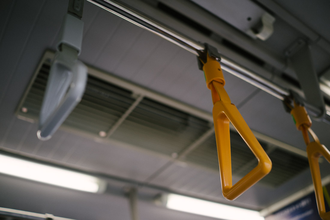 There are some priority seats and in those areas, if you're holding on to one of these yellow handles, you cannot use your phone. We think it forces you to pay attention to whatever priority passengers you have by your side (pregnant ladies, elderly and disabled people, etc).