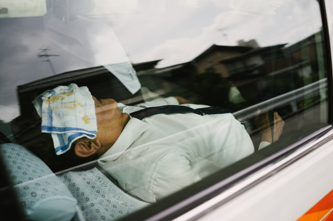 Many taxi drivers leave their cars running to have air conditioning on and catch some zzzs.